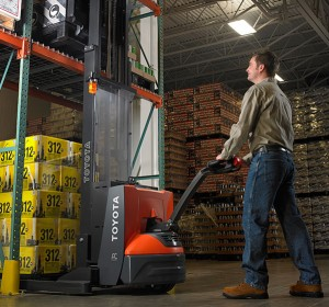 Toyot Electric Walkie Stacker lifting pallet of beverages off warehouse racking