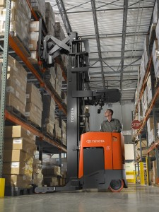 Electric Reach Truck lifting pallet off racking in narrow aisle