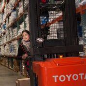 Associate using reach truck