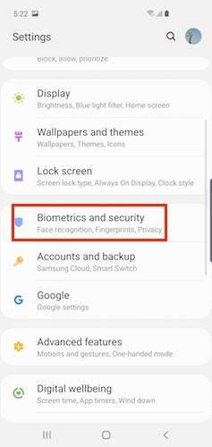 How do I use the ultrasonic in-screen fingerprint scanner