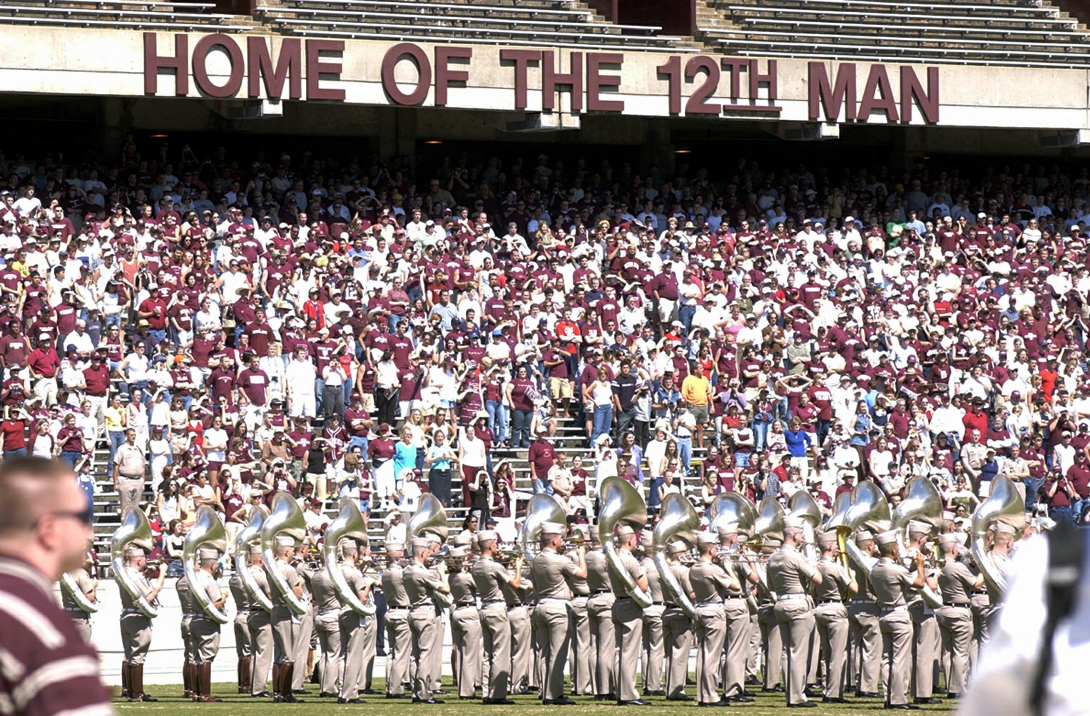 """** FILE ** Texas A&M fans fill the first tier of stands during the Maroon and White game, in this  April 12, 2003 photo, in College Station, Texas.  As if the Terrible Towel-twirling faithful of the Pittsburgh Steelers weren't enough, now Seattle Seahawks fans have to ward off another set of rabid football partisans: the Aggies of Texas A&M. Ever since the university launched a trademark dispute this week over who is allowed to refer to their fans as the """"12th Man,"""" David Israel, president of the Seahawks' official fan club, has attracted plenty of abuse. (AP Photo/Bryan-College Station Eagle, Butch Ireland)"""