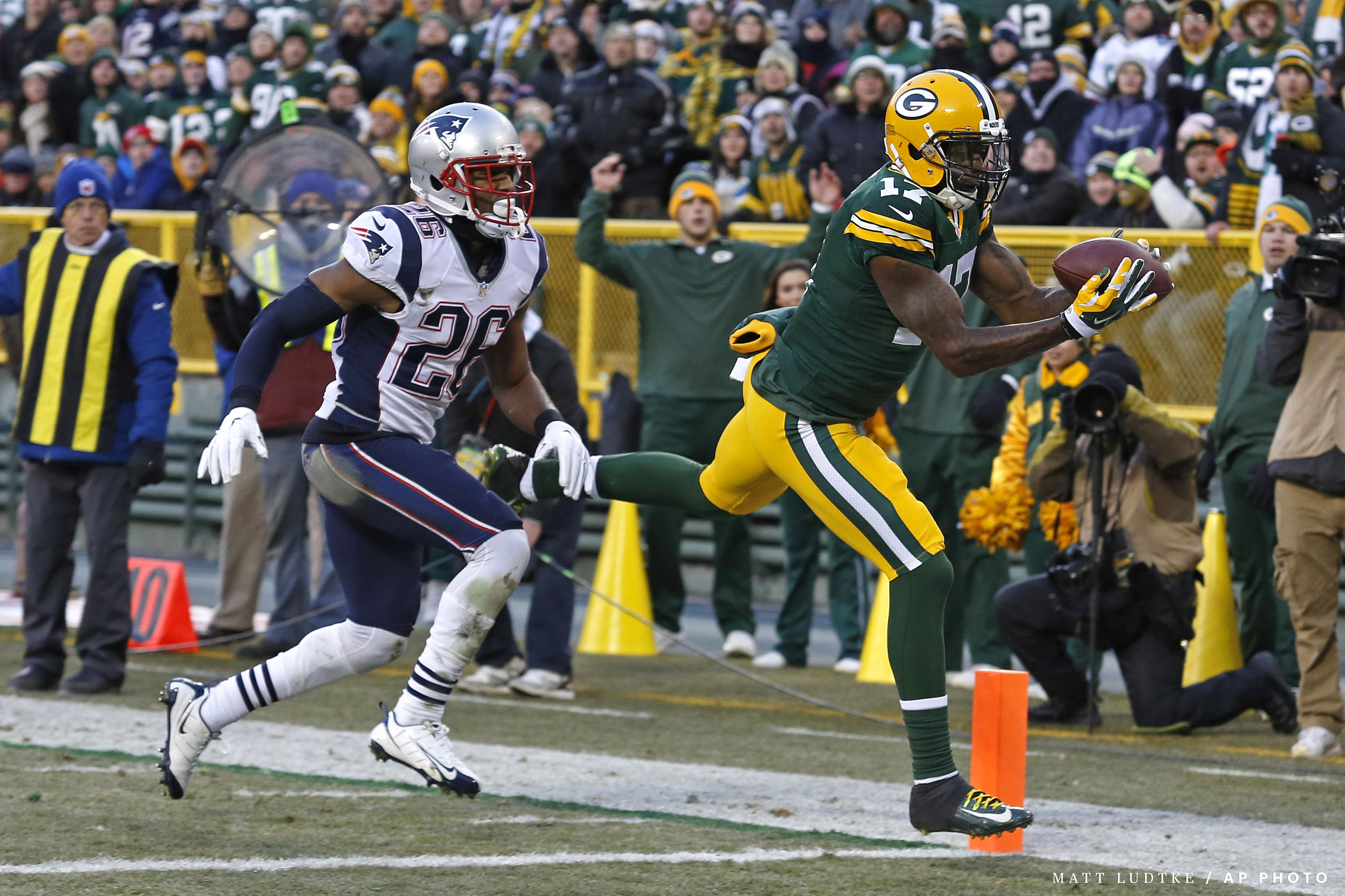 Green Bay Packers wide receiver Davante Adams tries to make a catch while being covered by New England Patriots cornerback Logan Ryan during an NFL football game Sunday Nov. 30, 2014, in Green Bay, Wis. (AP Photo/Matt Ludtke)