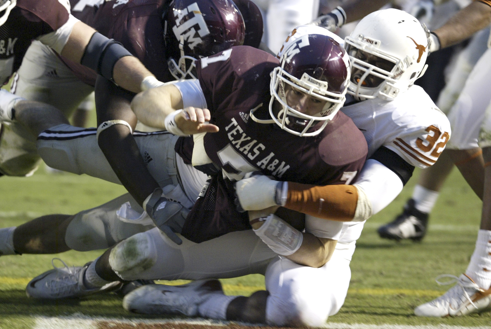 Texas A&M quarterback Stephen McGee (7) dives into the end zone for a touchdown as Texas' Eddie Jones (32) tackles him during the third quarter of a football game Friday, Nov. 23, 2007, in College Station, Texas. Texas A&M beat Texas 38-30. (AP Photo/Paul Zoeller)
