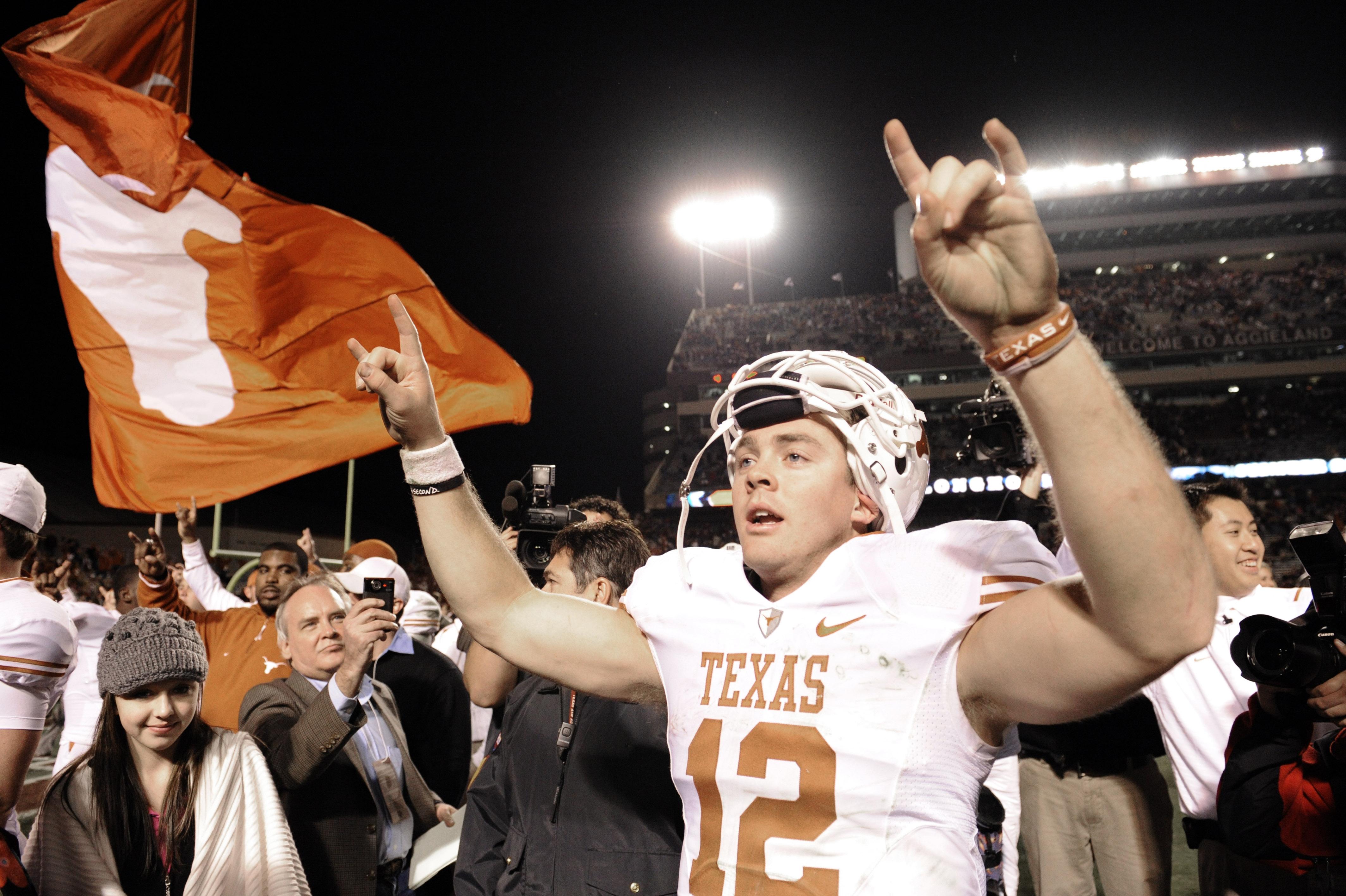 Texas quarterback Colt McCoy (12) celebrates after their NCAA college football game against Texas A&M Thursday, Nov. 26, 2009 in College Station, Texas. Texas beat Texas A&M 49-39. (AP Photo/Dave Einsel)