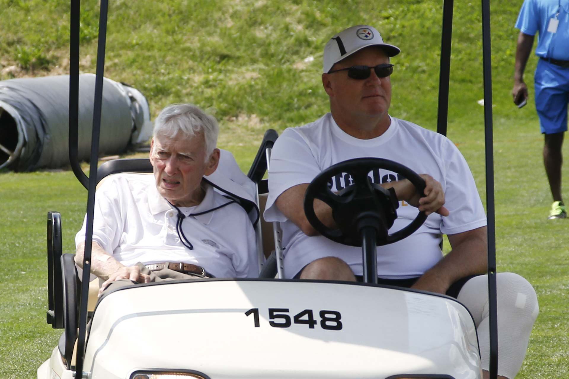 Pittsburgh Steelers chairman Dan Rooney, left, arrives with team general manager cat the beginning of the Steelers first practice at NFL football training camp in Latrobe, Pa. on Sunday, July 26, 2015. (AP Photo/Keith Srakocic)