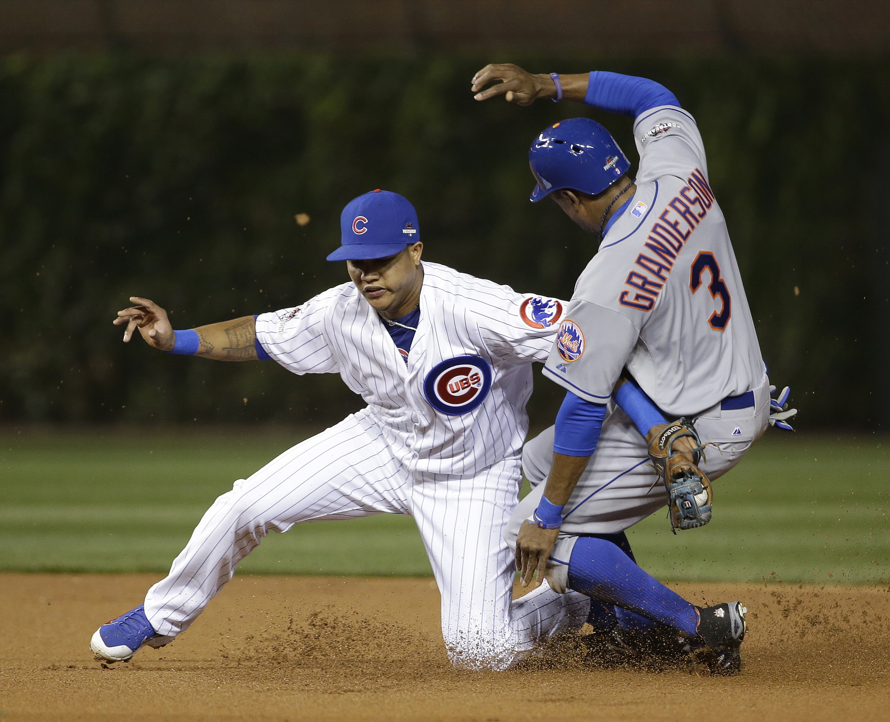 New York Mets' Curtis Granderson steals second with Chicago Cubs' Starlin Castro covering during the first inning of Game 4 of the National League baseball championship series Wednesday, Oct. 21, 2015, in Chicago. (AP Photo/David J. Phillip)