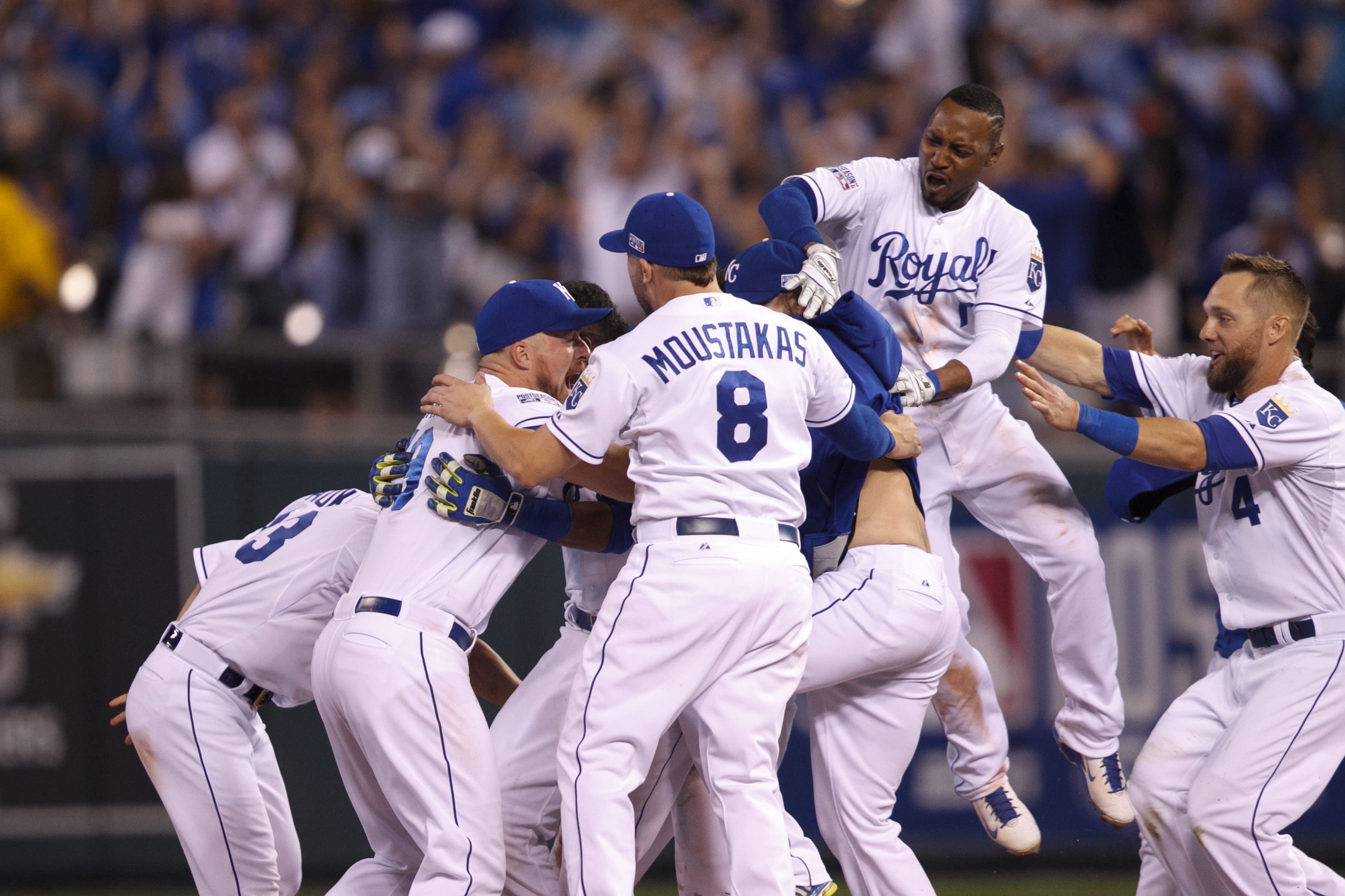 September 30, 2014: Kansas City Royals players celebrate after catcher Salvador Perez (13) hit a game winning single in the bottom of the 12th inning during the American League Wild Card game between the Oakland A's and the Kansas City Royals at Kauffman Stadium in Kansas City, Missouri. The Royals defeated the A's 9-8 in 12 innings. (Icon Sportswire via AP Images)