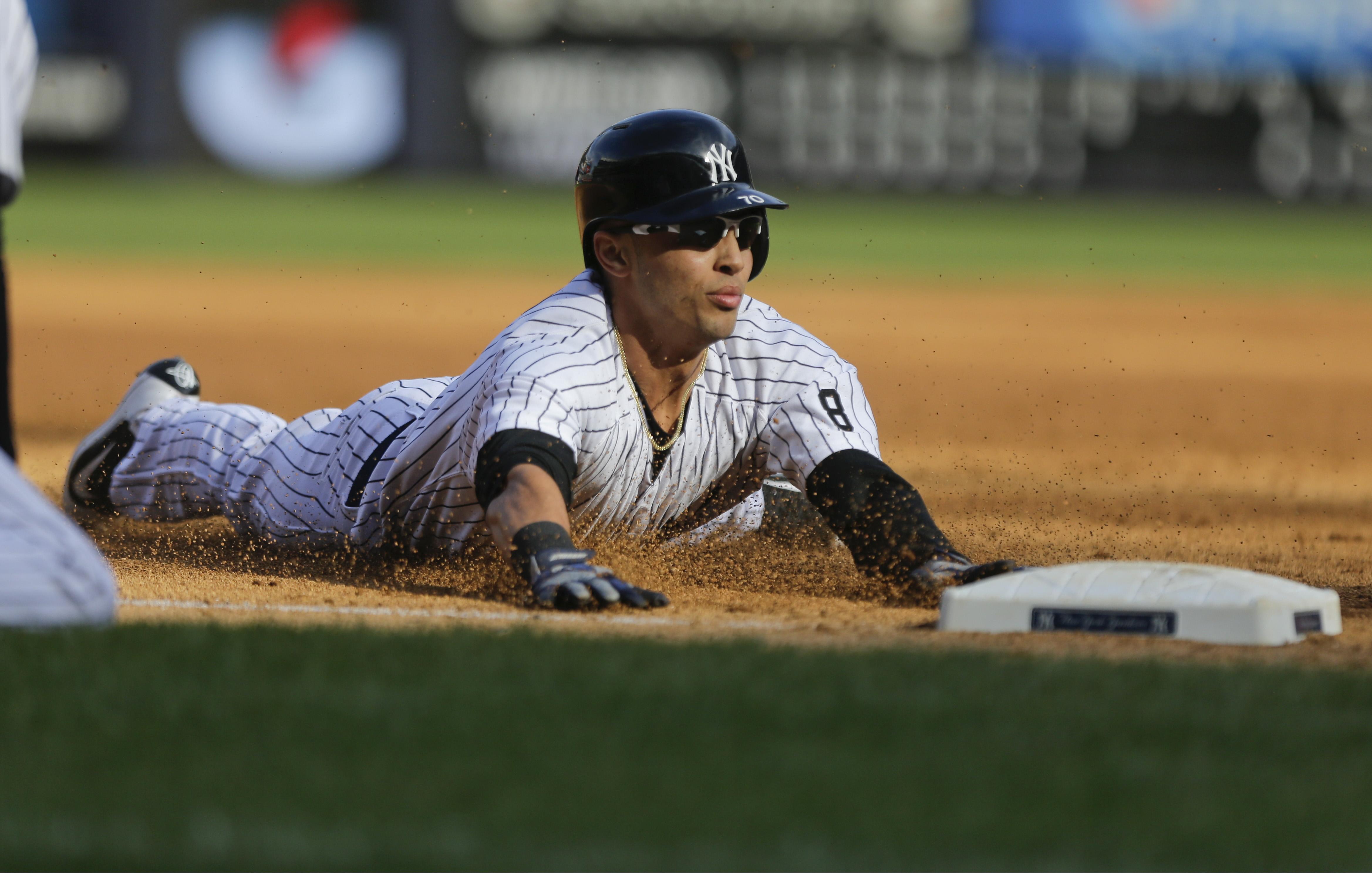New York Yankees center fielder Rico Noel (70) sildes to third base after advancing on a throwing error by Chicago White Sox relief pitcher Daniel Webb on a pick off attempt during the eighth inning of a baseball game, Sunday, Sept. 27, 2015, in New York. (AP Photo/Frank Franklin II)