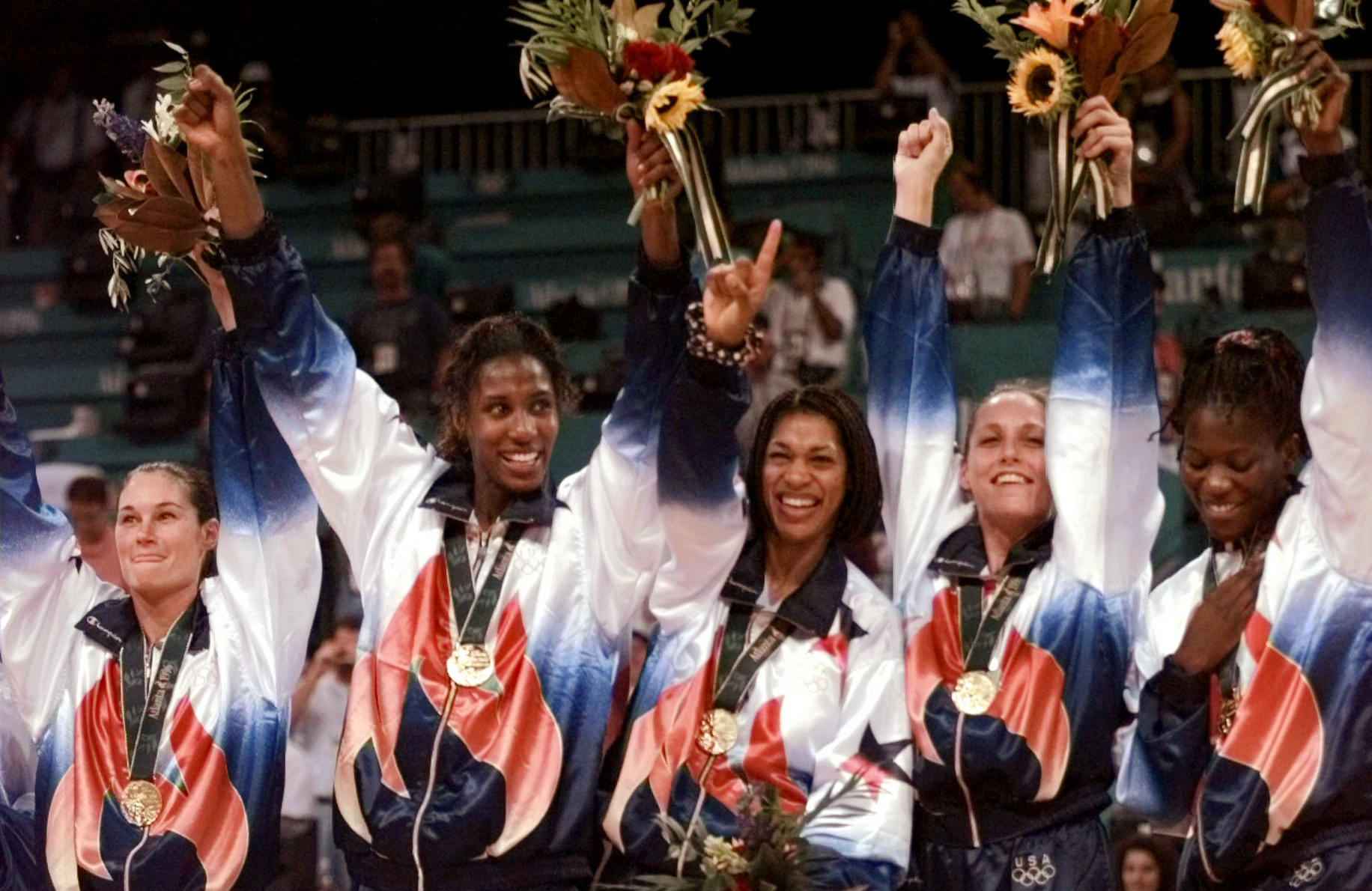 United States' women's basketball team members wear their gold medals during medal ceremonies in basketball at the Centennial Summer Olympic Games in Atlanta Sunday, August 4, 1996. Team members from left are: Jennifer Azzi, Lisa Leslie, Carla McGhee, Katy Steding and Sheryl Swoopes. The United States defeated Brazil 111-87 for the gold medal in women's basketball. (AP Photo/Susan Ragan)