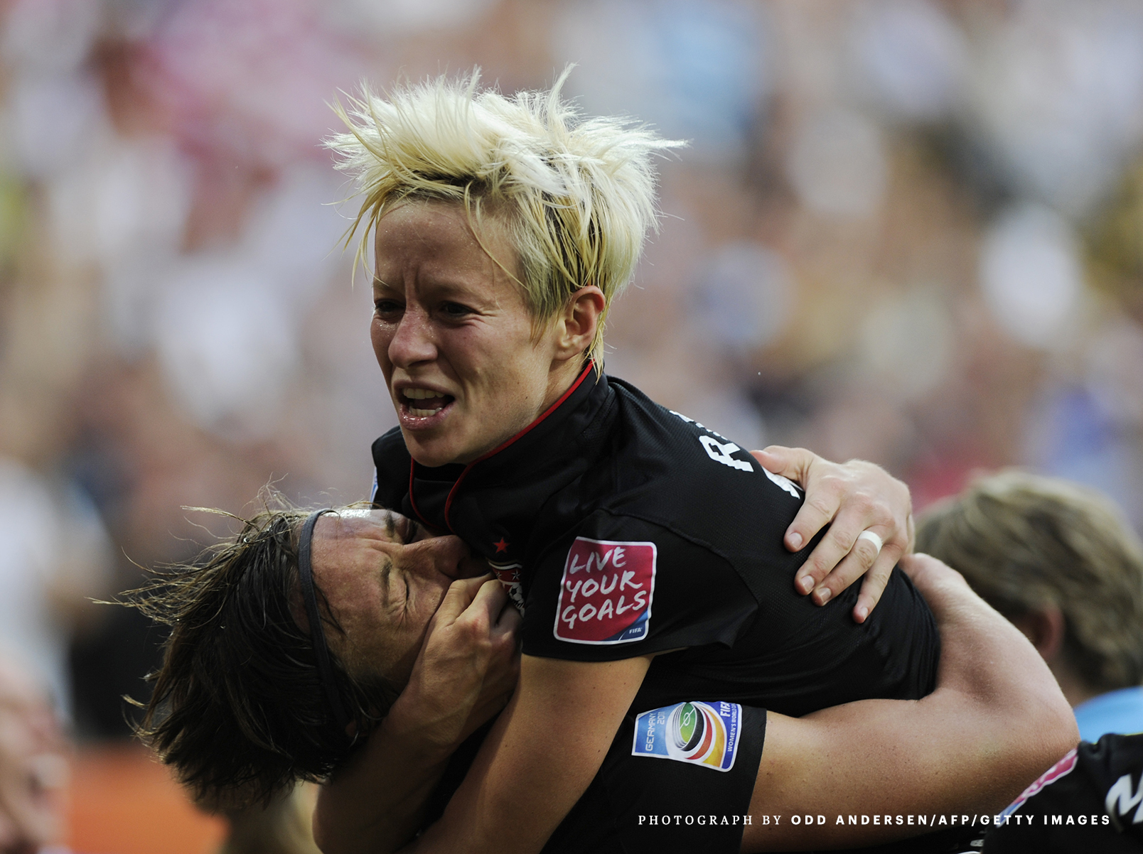 USA's striker Abby Wambach (L) celebrate
