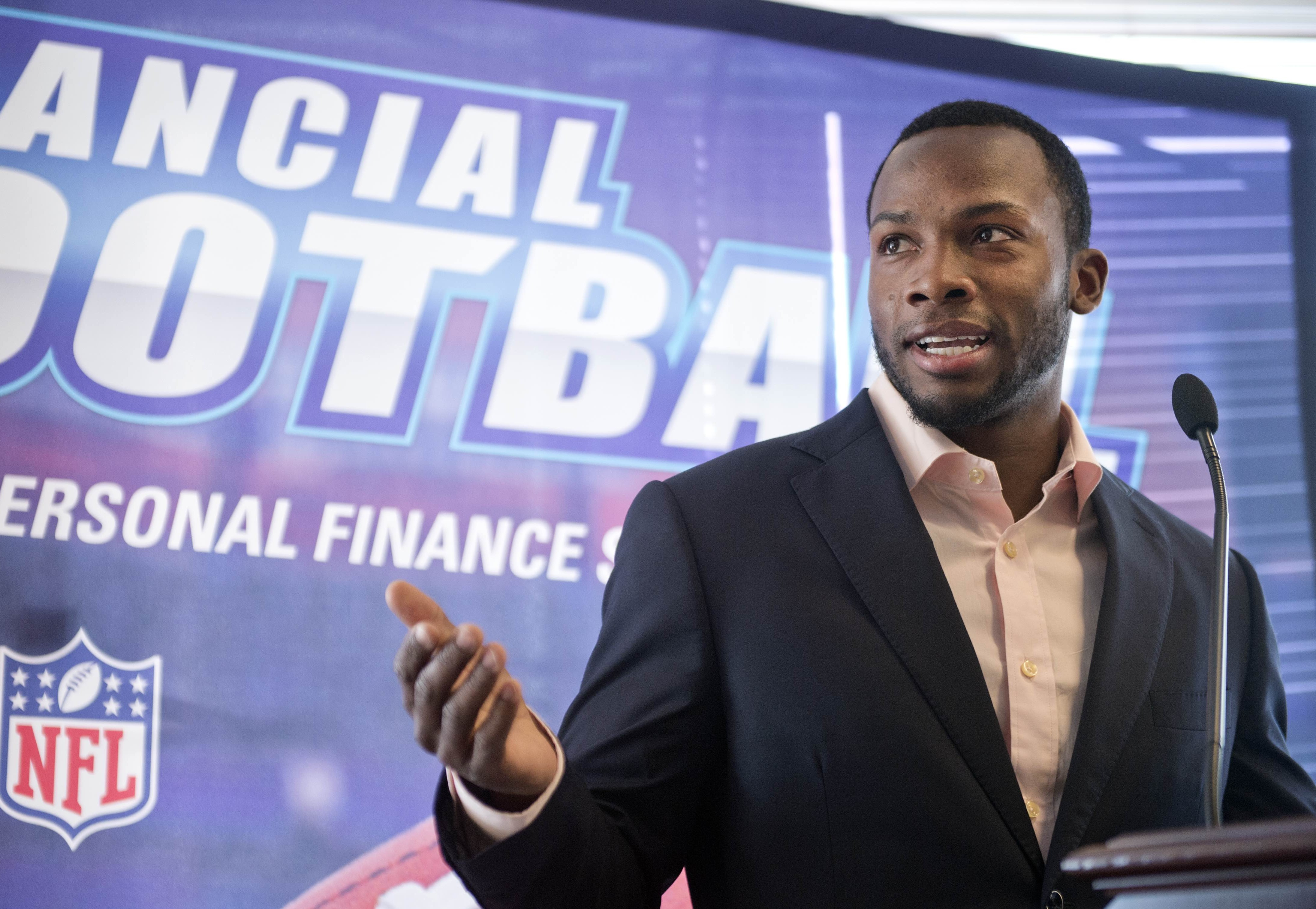 """UNITED STATES - MARCH 18: Detroit Lions wide receiver Ryan Broyles speaks during an event at 101 Constitution Avenue with the National Bankers Association, Visa, and NFL players, to educate teens about financial responsibility, March 18, 2015. At the event, teens and NFL athletes Heisman Trophy winner and New Orleans Saints running back Mark Ingram and Broyles, played """"Financial Football,"""" a free educational video game that incorporates football and questions about money management. (Photo By Tom Williams/CQ Roll Call)"""