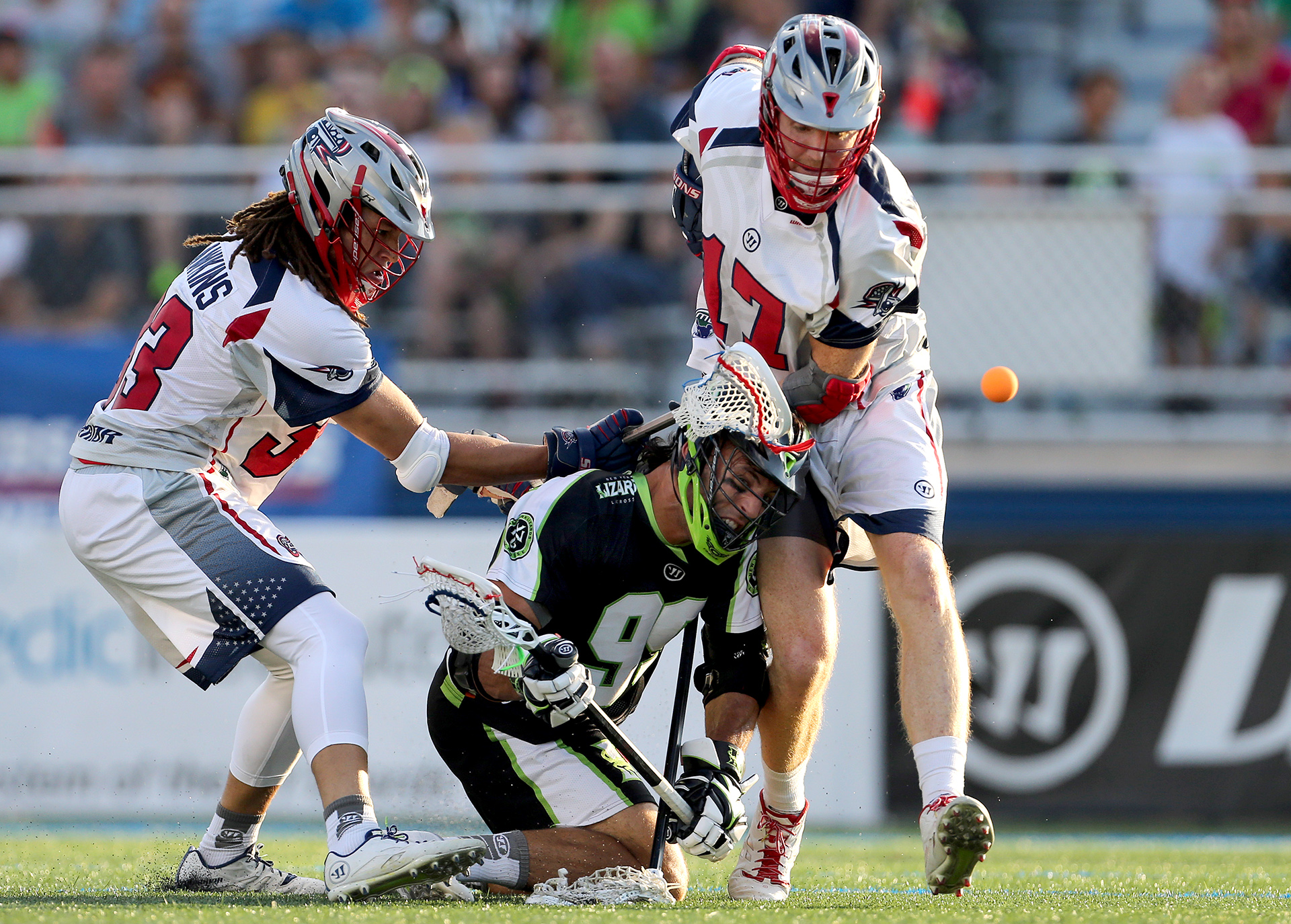 HEMPSTEAD, NY - AUGUST 1: Paul Rabil #99 of the New York Lizards has the ball knocked away between Josh Hawkins #33 of the Boston Cannons and Brodie Merrill #17 also of the Cannons at James M. Shuart Stadium on August 1, 2015 in Hempstead, New York. (Photo by Adam Hunger/Getty Images)