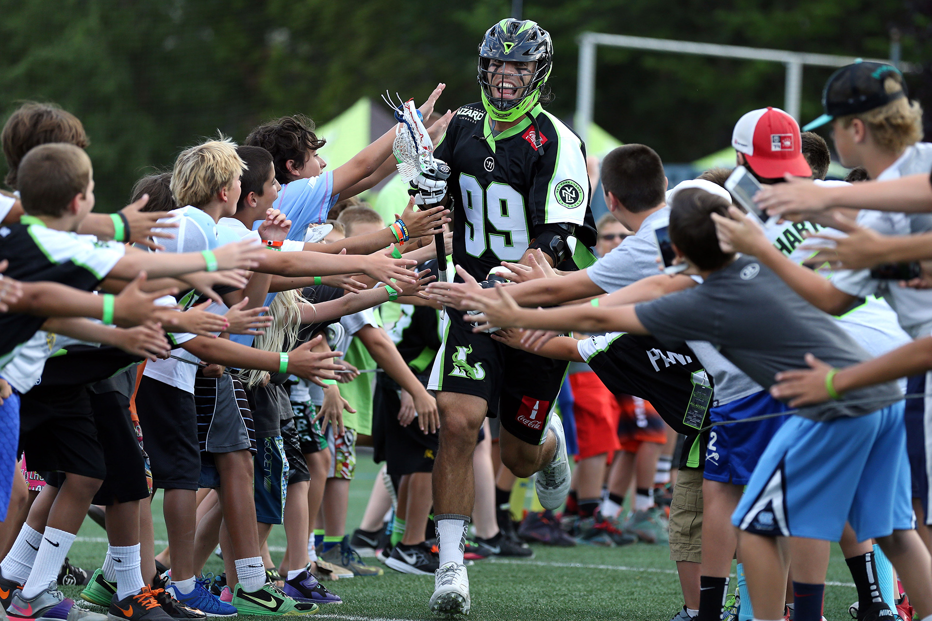 HEMPSTEAD, NY - AUGUST 1: Paul Rabil #99 of the New York Lizards is announced prior to taking on the Boston Cannons at James M. Shuart Stadium on August 1, 2015 in Hempstead, New York. (Photo by Adam Hunger/Getty Images)