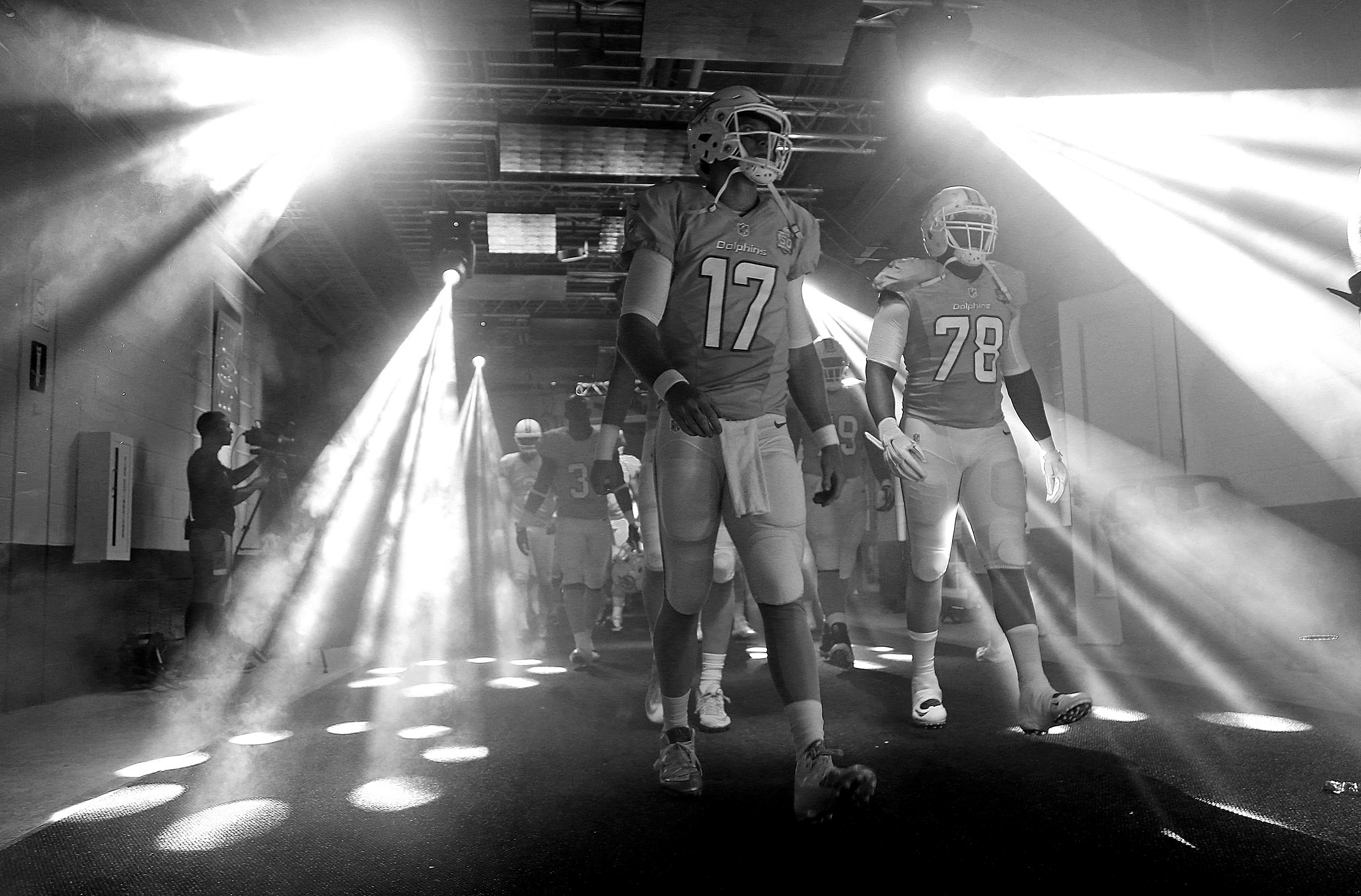 MIAMI GARDENS, FL - AUGUST 29: (EDITORS NOTE: Image has been converted to black and white.) Ryan Tannehill #17 of the Miami Dolphins takes the field during a preseason game against the Atlanta Falcons at Sun Life Stadium on August 29, 2015 in Miami Gardens, Florida.  (Photo by Mike Ehrmann/Getty Images)