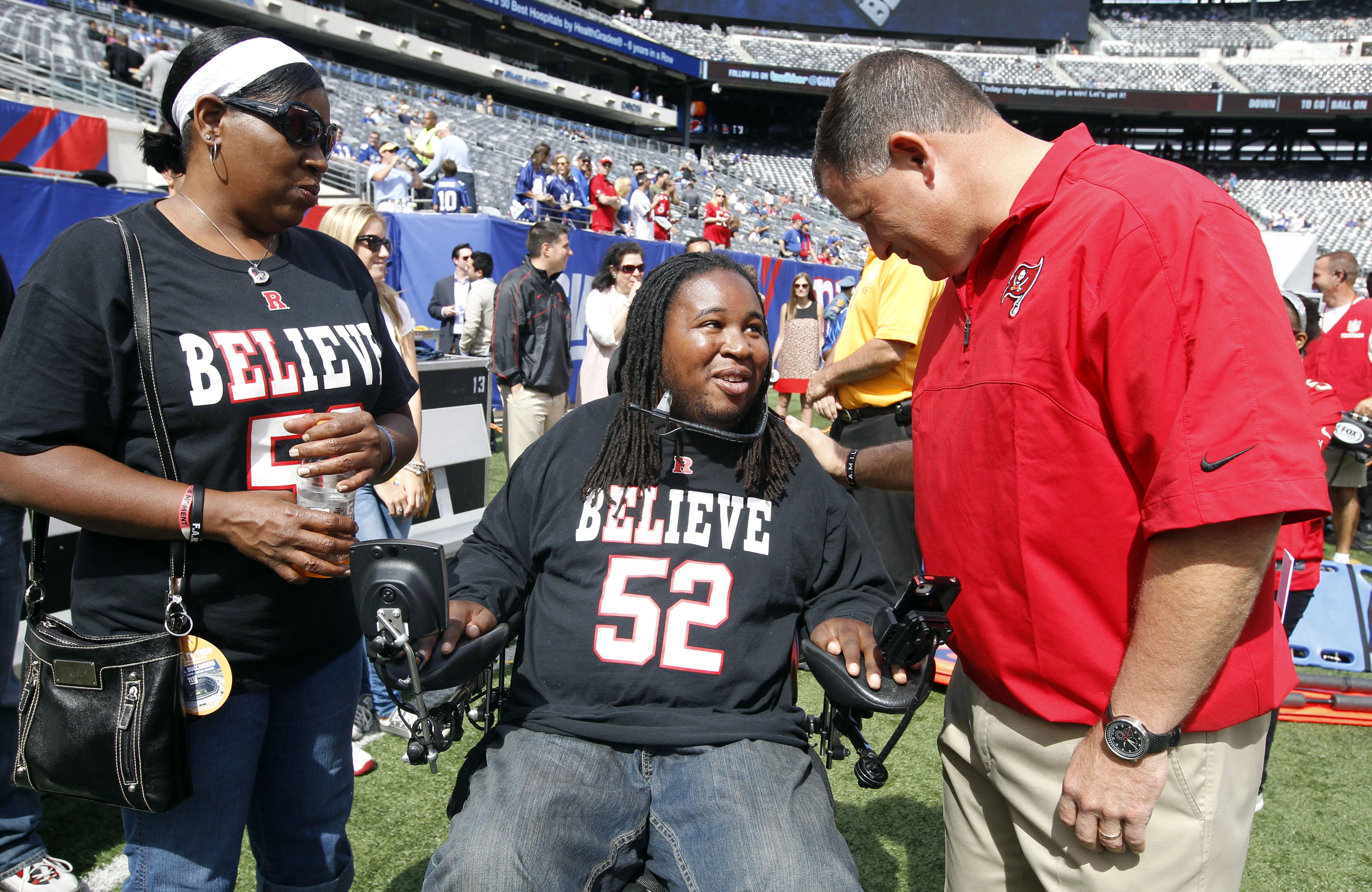 Sep 16, 2012; East Rutherford, NJ, USA; Karen LeGrand with her son Eric LeGrand  talk with Tampa Bay Buccaneers head coach Greg Schiano before the game against the New York Giants at MetLife Stadium.  Mandatory Credit: William Perlman/THE STAR-LEDGER via USA TODAY Sports