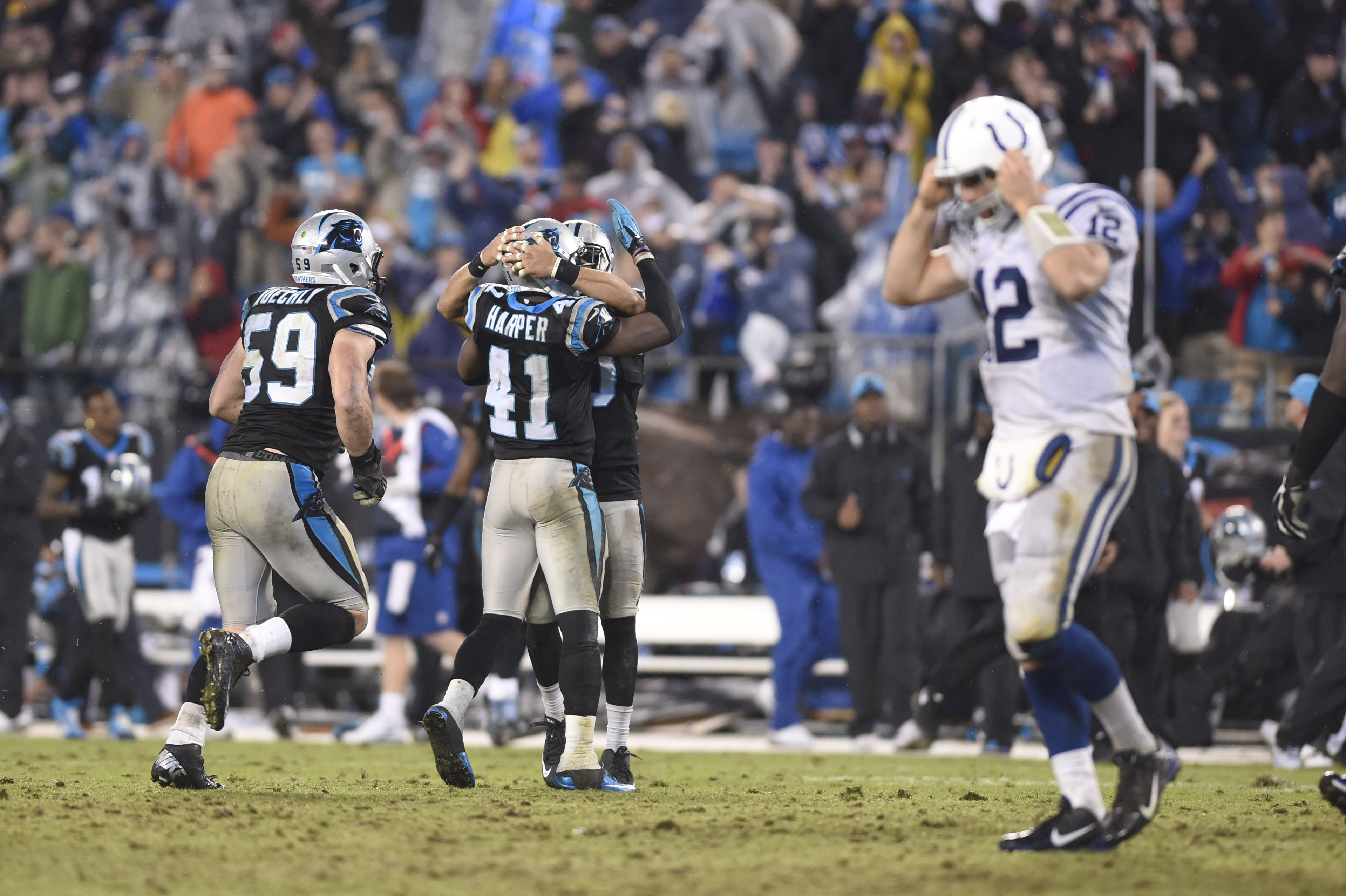 Nov 2, 2015; Charlotte, NC, USA; Carolina Panthers strong safety Roman Harper (41) and middle linebacker Luke Kuechly (59) celebrate after Kuechly intercepts the ball in overtime as Indianapolis Colts quarterback Andrew Luck (12) is in the foreground. The Panthers defeated the Colts in overtime 29-26 at Bank of America Stadium. Mandatory Credit: Bob Donnan-USA TODAY Sports