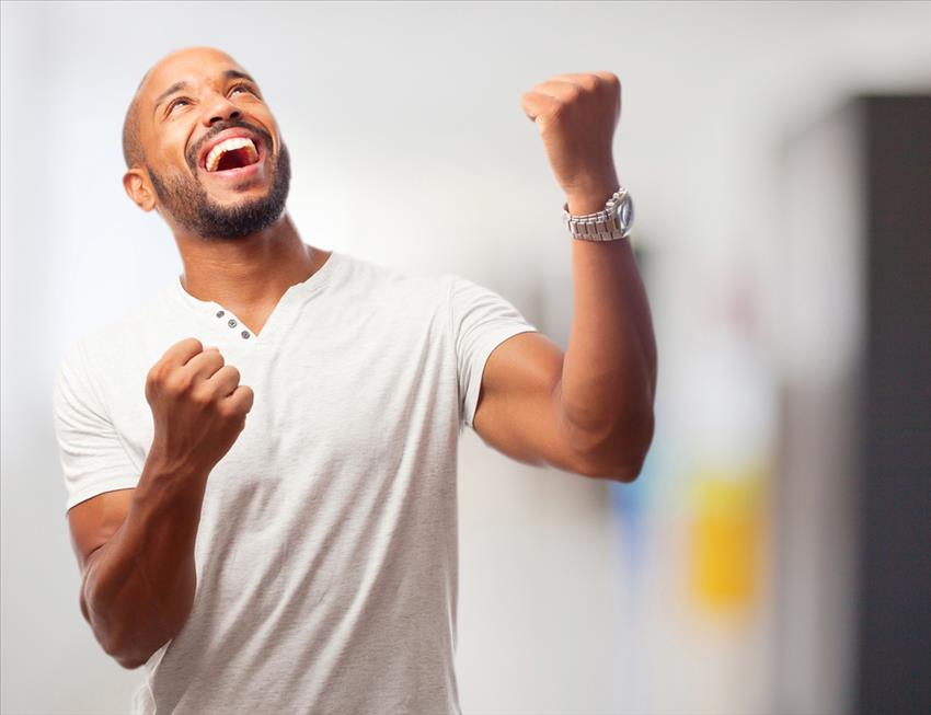 celebrate success man expressing celebratory look