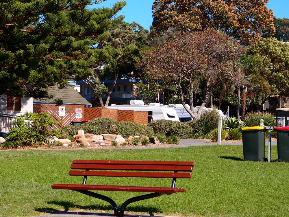 Kendalls Beach bench and holiday park cabins