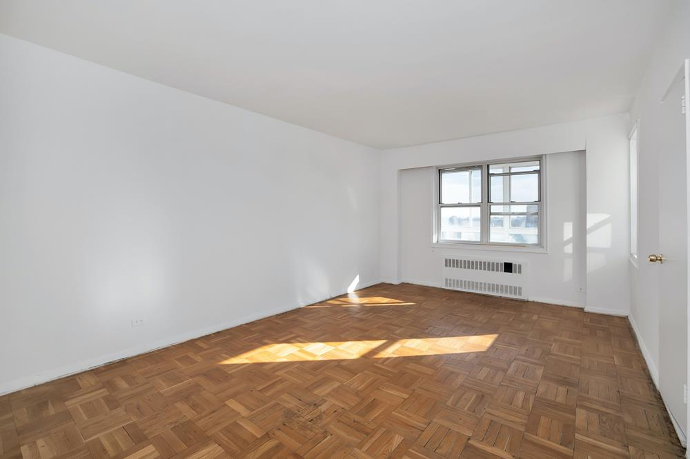Spacious Top-Floor 2-Bd. Co-op w/ Enclosed Sunrise Balcony, Parking & 24-Hr. Doormen