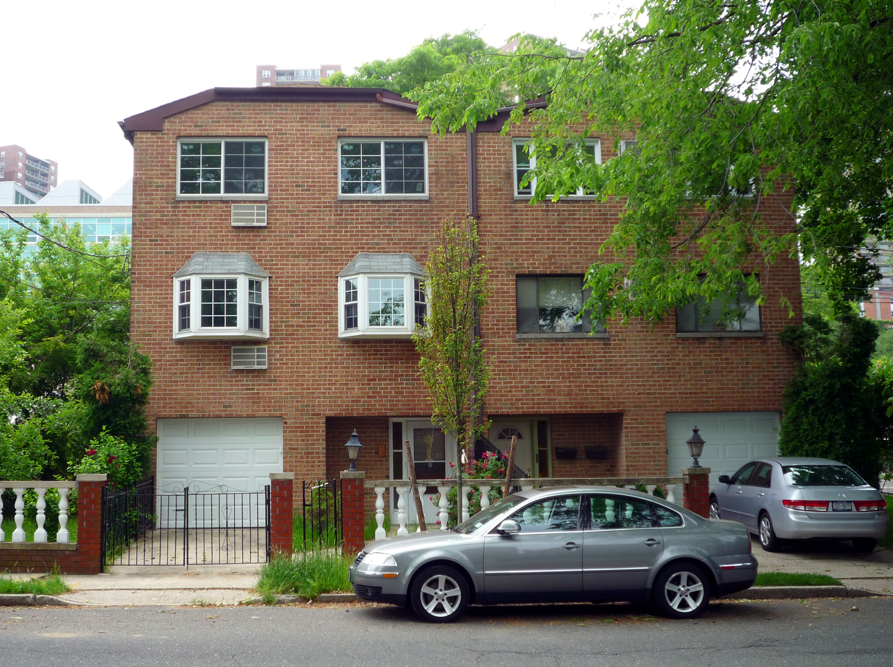 2-Family, Brick Townhouse w/ Spacious Side & Rear Yards
