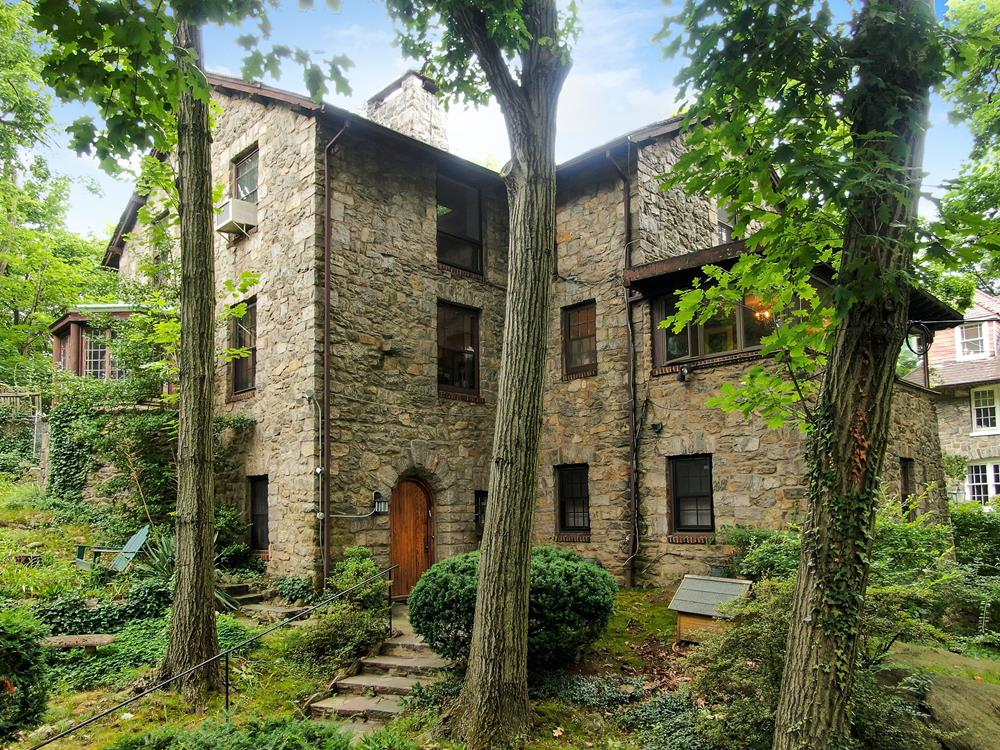 Secluded Stone House w/ 2 Sunrooms + Front & Back Patios on a Tree-Lined Cul-de-Sac