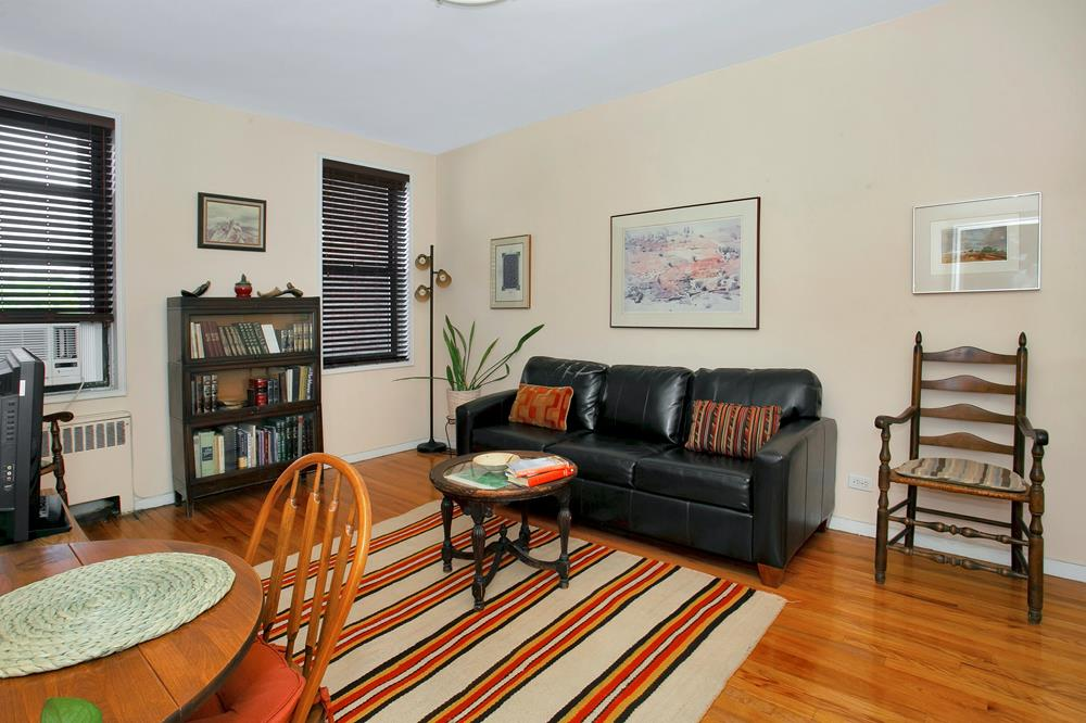 Spacious Split-Design 2-Bd., 2-Bath Co-op w/ Indoor Parking, Balcony, & Doormen