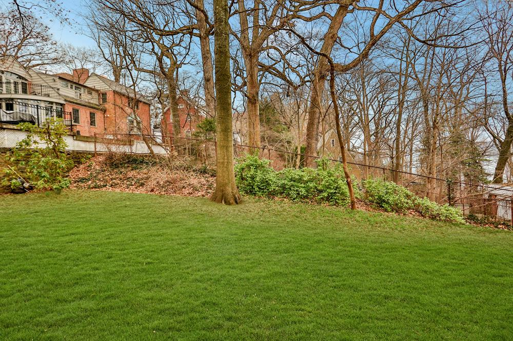 Picturesque 4-Bd. Tudor-Style House on Double Lot with Grassy Yard & River Views on Private Cul-de-Sac