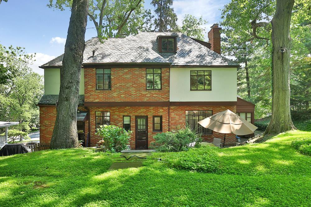 Classic 4-Bd. Tudor-Style House with Patio, Spacious Lawns & Garden