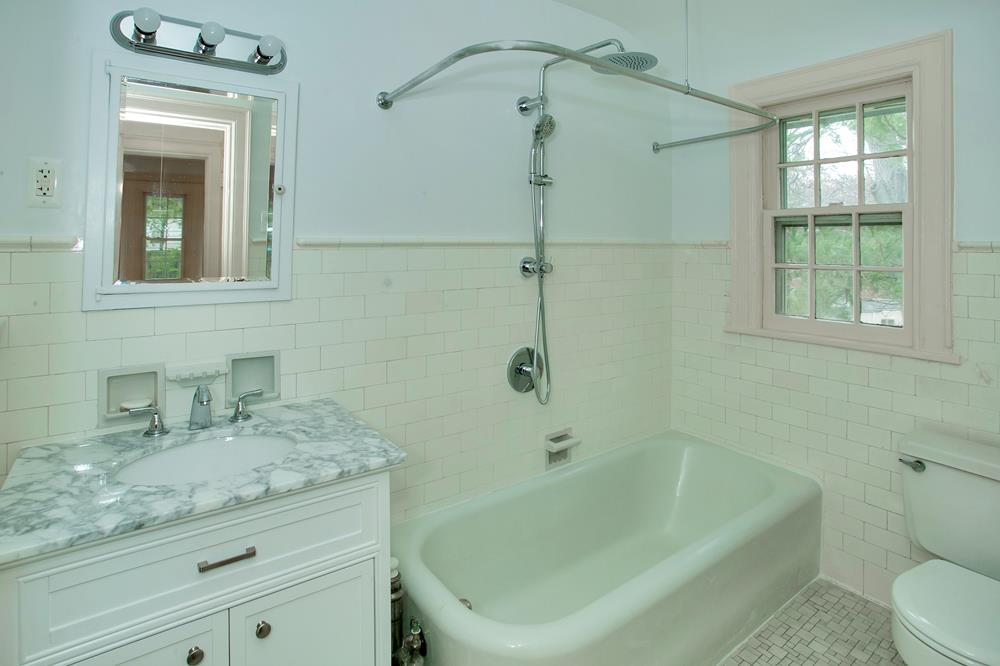 Picturesque 1920s 3-Bd. Stone & Stucco House with Spacious Grounds