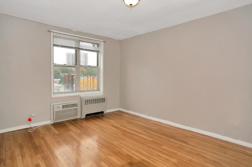 Bright 2-Bd. Postwar Co-op w/ Hardwood Floors and South & West Exposures