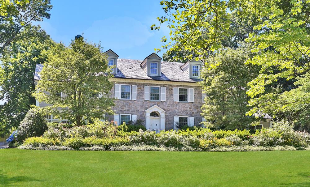 Stately, Secluded Georgian Revival Stone Residence Situated on Nearly Three Quarters of an Acre