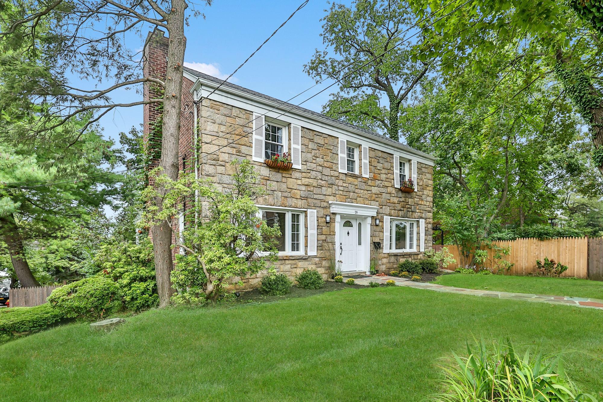 4-Bd. Stone & Brick Colonial w/ Lawns & Patio