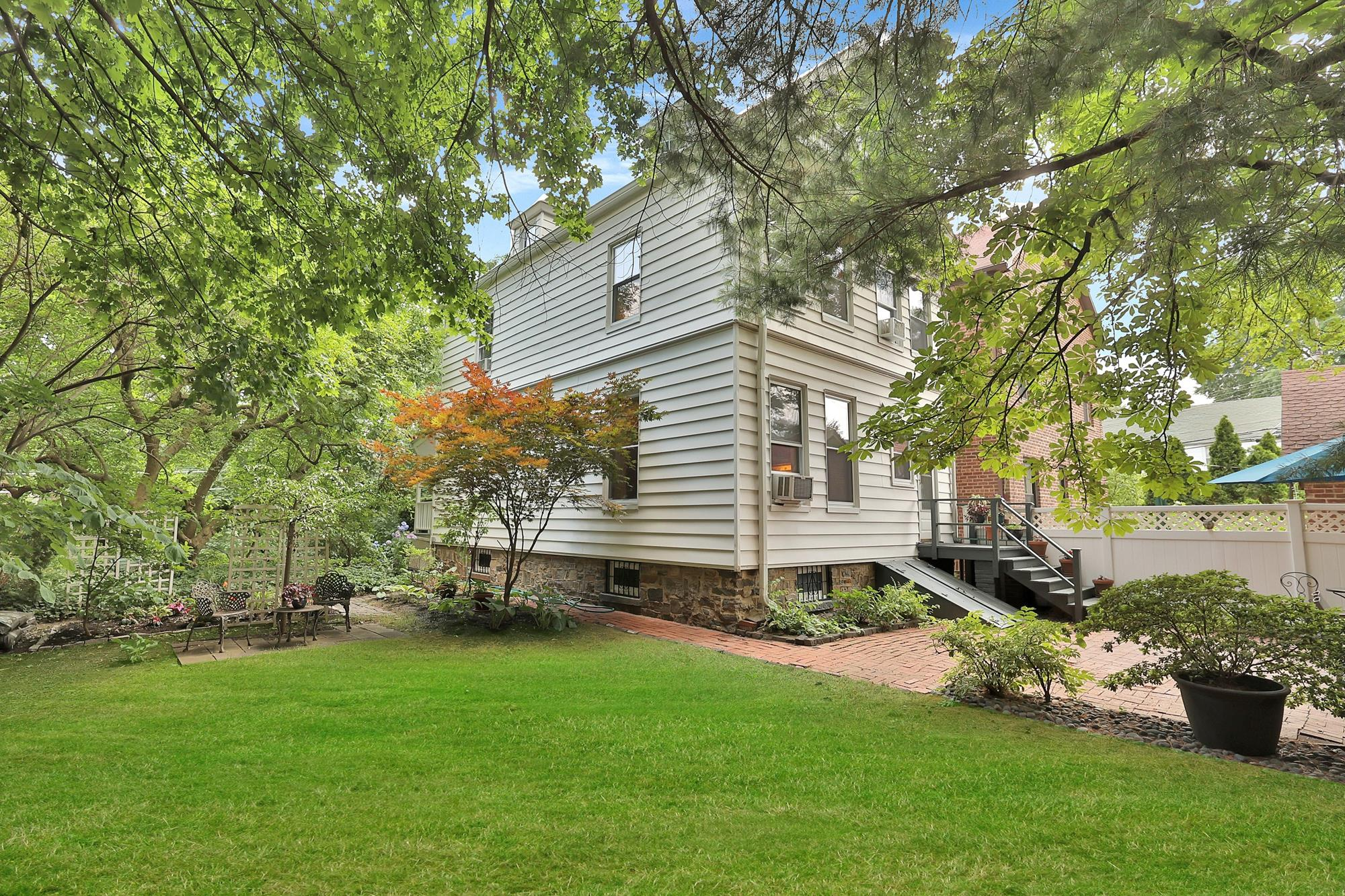 Charming 6-Bd. House on Double Lot with Lovely Side & Back Yards, Patio & Garden