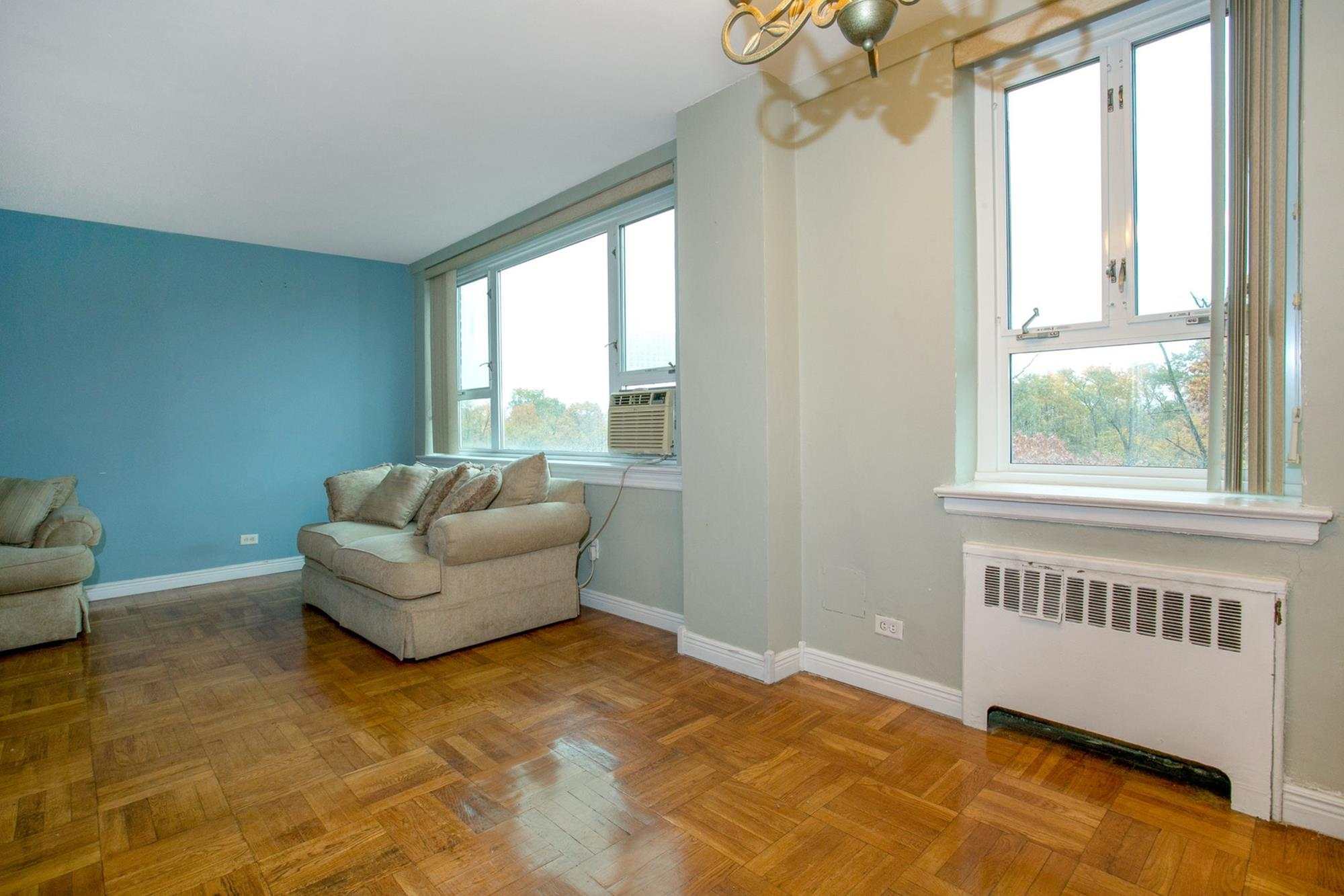 Junior-4 Postwar Co-op w/ Sunrise Balcony & 24-hr. Doorman at 5355 Henry Hudson Parkway