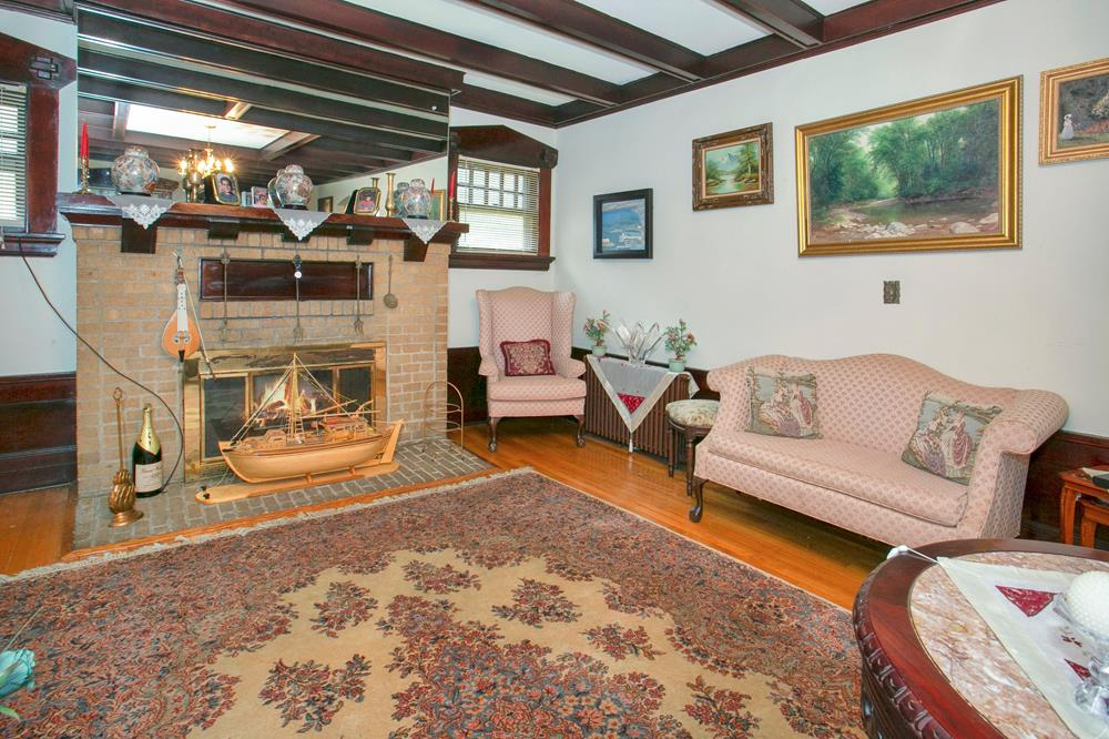 Spacious 7-Bd. Tudor-Style House with Grassy Yard on Double Lot Along Tree-Lined Street