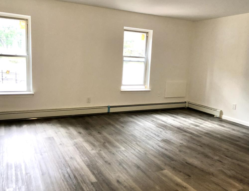 Totally Renovated 2-Bd., 1.5-Bath apartment in 3-family house conveniently located on Riverdale Ave. close to transportation & shops.  Laundry in building.