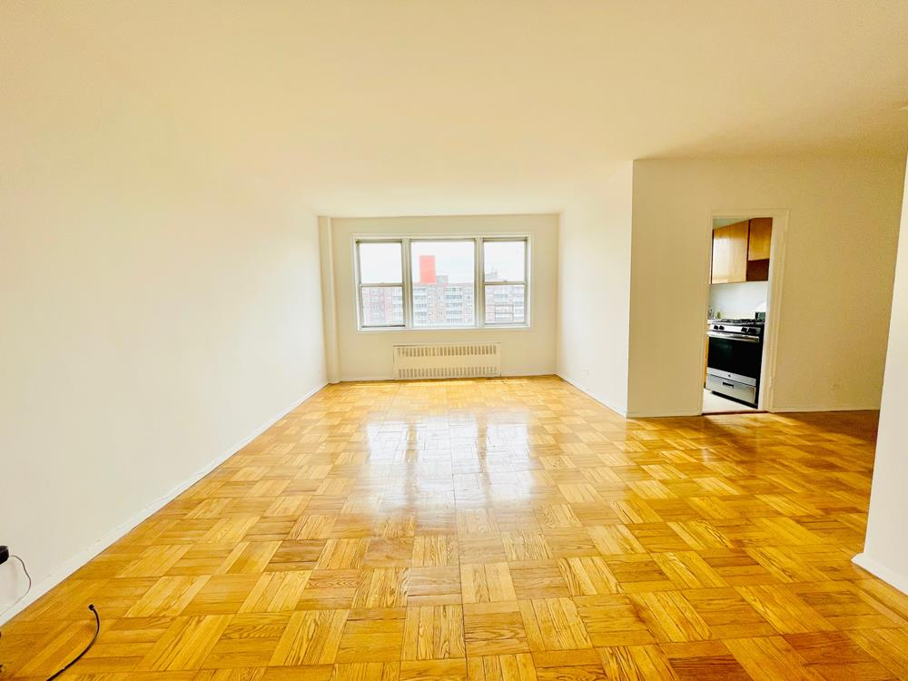 RENT STABILIZED - Bright 1 Bedroom on Top Floor with Doorman, Fitness Room, near shops, transportation & dog run.!!!