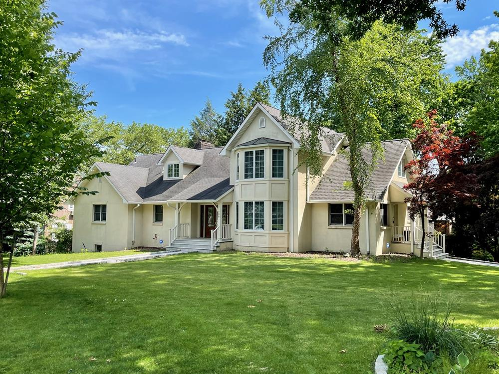 Spacious 4-Bd. Stucco House with Patio & Level, Grassy Yard