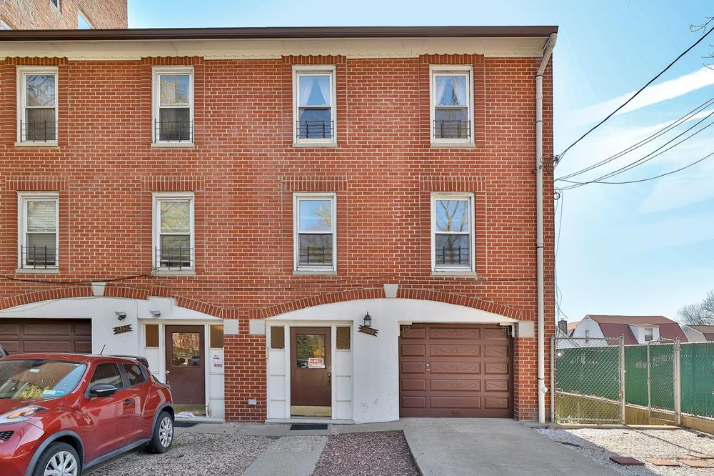 3-Family Townhouse w/ Driveway, Patio & Garage
