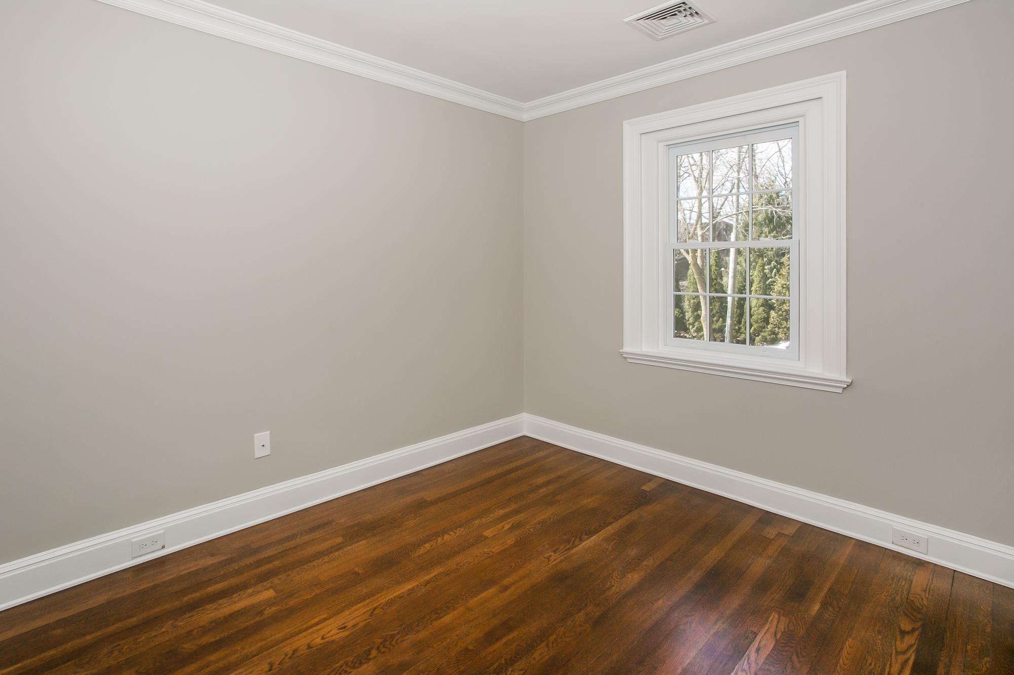 NEW RENOVATION: Classic 4-Bd. Brick Center-Hall Colonial on Grosvenor Avenue
