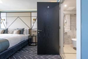 Dark wood veneer door seven hotel 1024x683