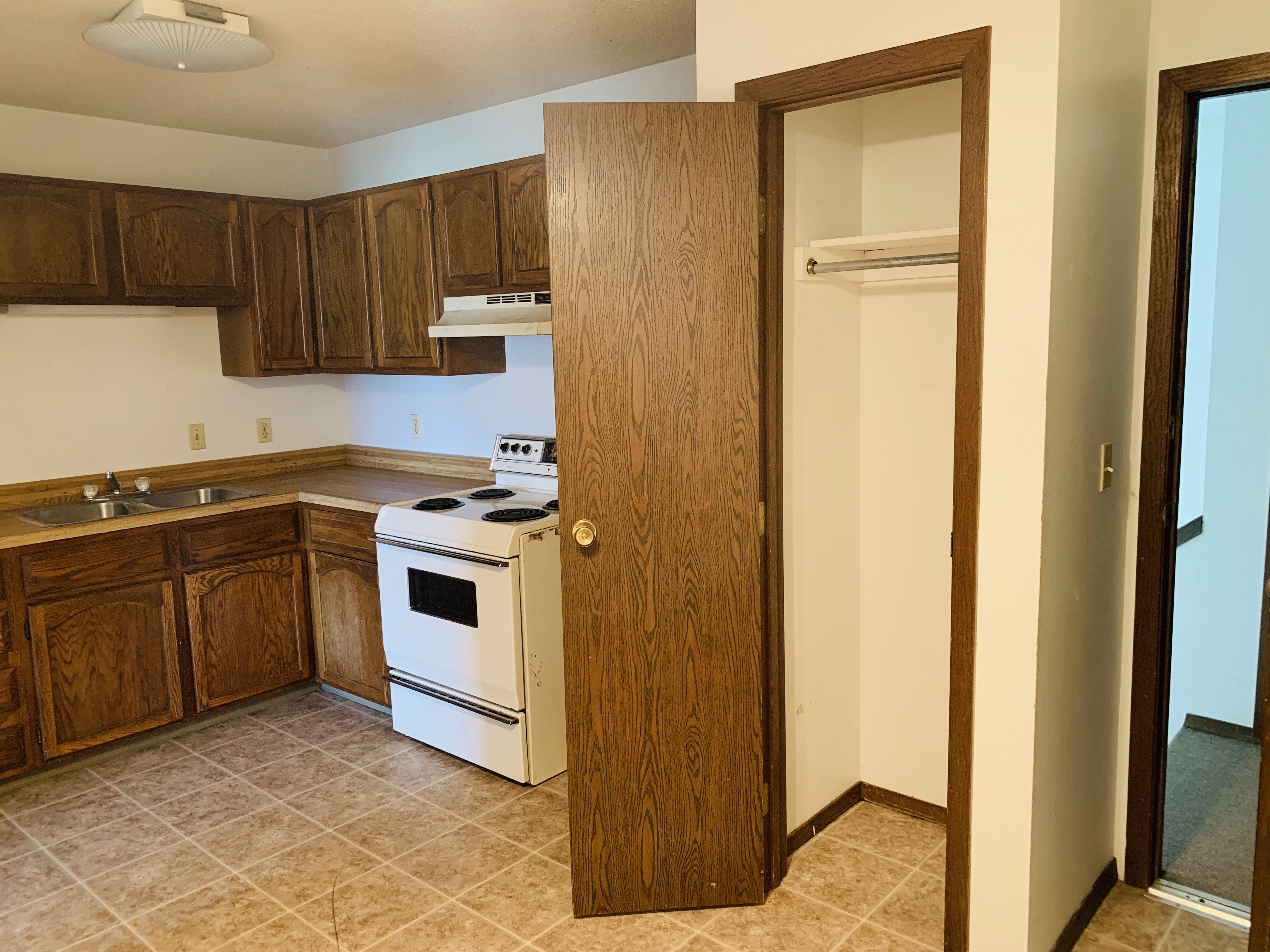 Coat closet in entry into kitchen