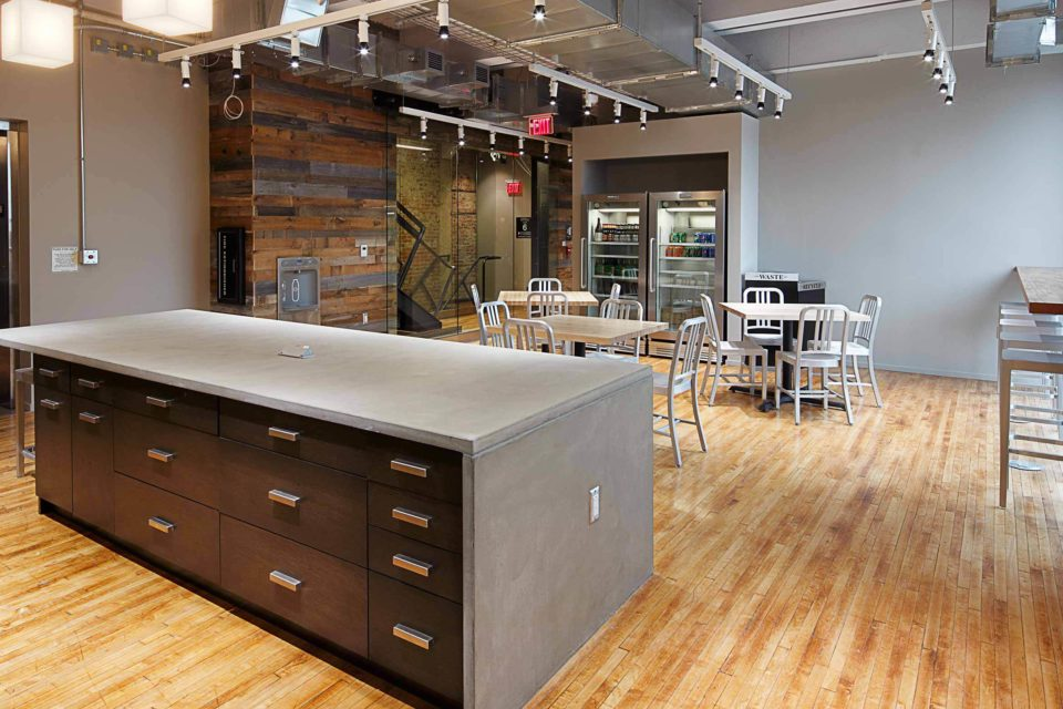 A large lunch room gives Trifecta Technologies team members space to gather at lunchtime.