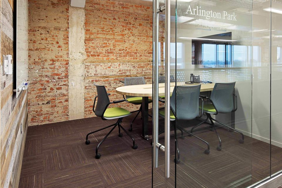 Trifecta Technologies team members use small meeting rooms for daily scrums and impromptu work sessions.