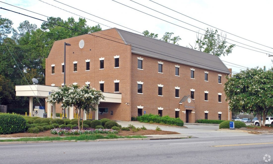 Trinity Partners' Roger Winn and Braden Shockley represent owner in sale of 4408 Forest Drive