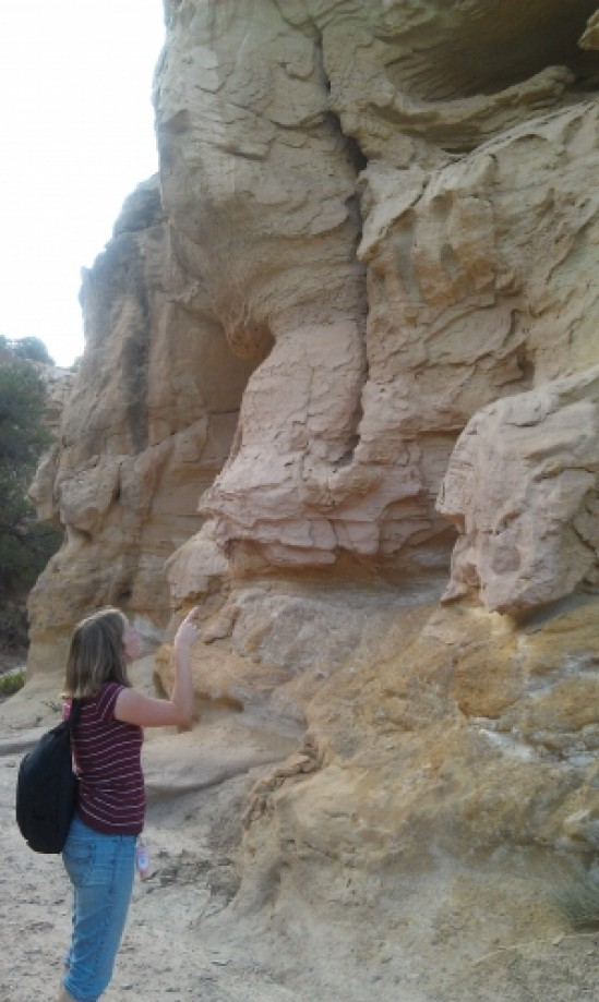 Trip photo #9/17 Tara Pointing to a Small Sandstone Cave