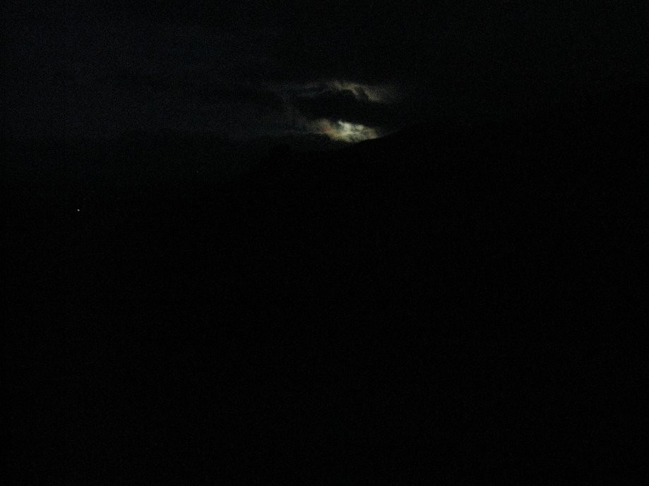 Trip photo #19/20 First glimpse of the full moon behind the clouds