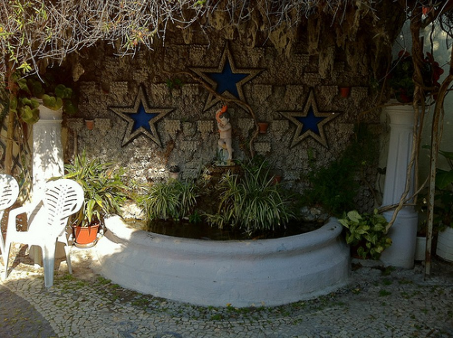 Trip photo #16/69 A decorated fountain in Vivenda Rosalina's garden (Bairro Estrela d'Ouro)