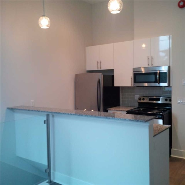 Condo Apartment at 323 Kingston Rd, Unit 102, Toronto, Ontario. Image 1