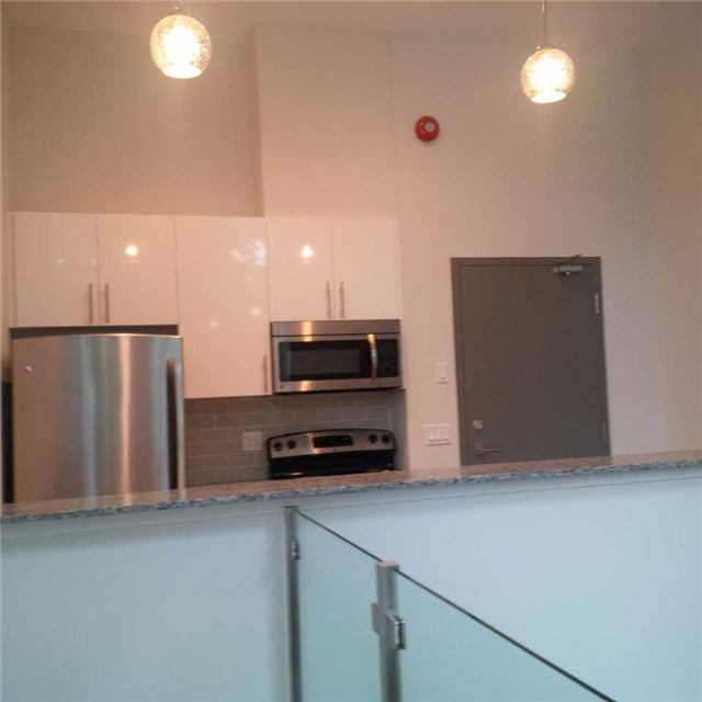 Condo Apartment at 323 Kingston Rd, Unit 102, Toronto, Ontario. Image 4